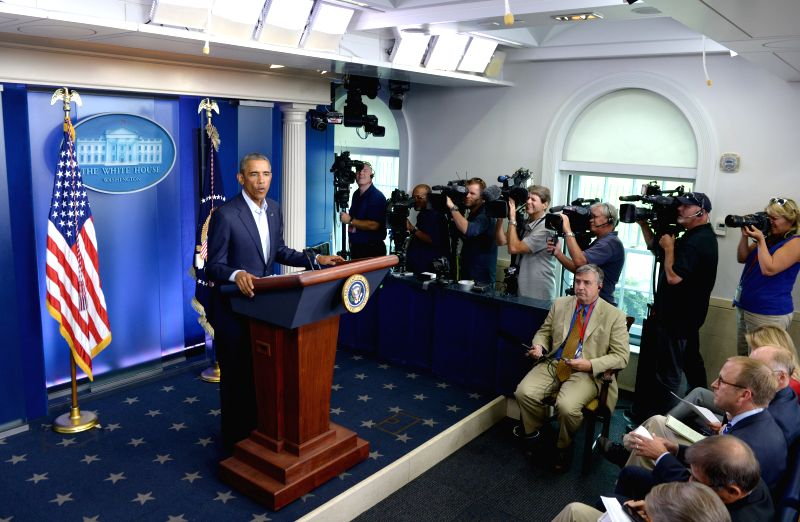 U.S. President Barack Obama speaks at the press briefing room of the White House in Washington D.C., the  United States, Aug. 18, 2014. Obama on Monday ...
