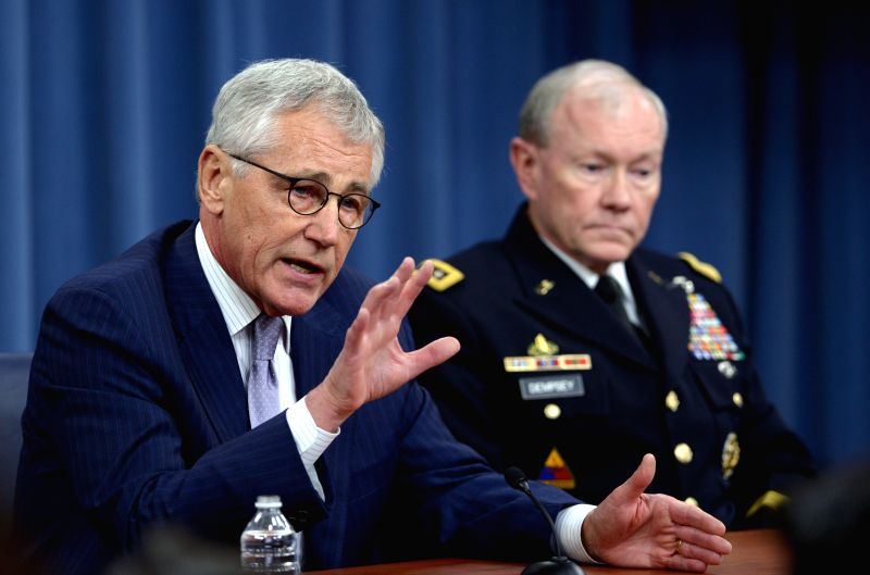 US Secretary of Defense Chuck Hagel (L) and Chairman of the Joint Chiefs of Staff General Martin Dempsey hold a press briefing at the Pentagon in ...