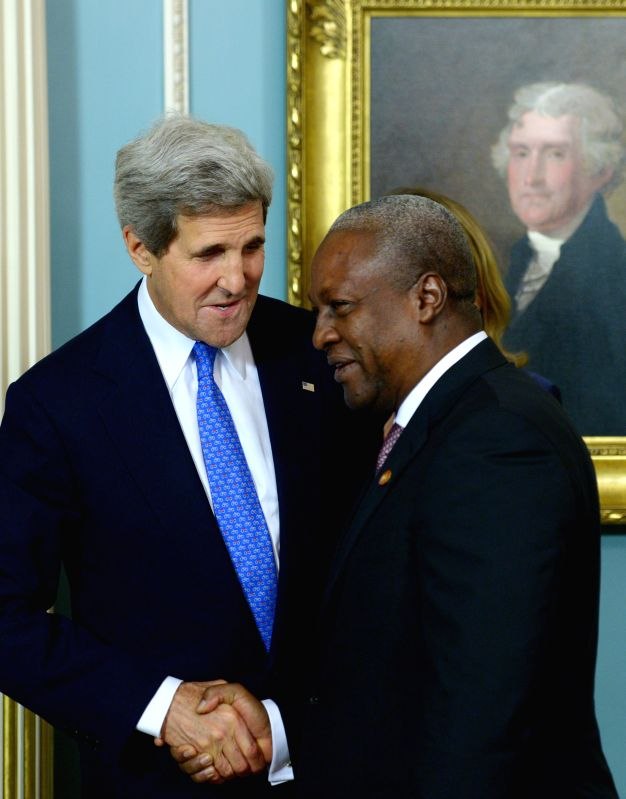 U.S. Secretary of State John Kerry(L) and Ghanaian President John Dramani Mahama participate in the Ghana Compact signing ceremony during the U.S.-Africa ...