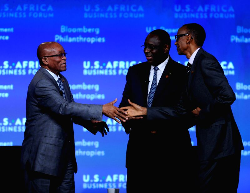 President of South Africa Jacob Zuma (L), President of Senegal Macky Sall (C)and President of Rwanda Paul Kagame attend the business forum of the first ...