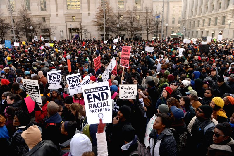 People attend a demonstration at the Freedom Plaza near the White House protesting against racism and police violence in Washington D.C., the United States,