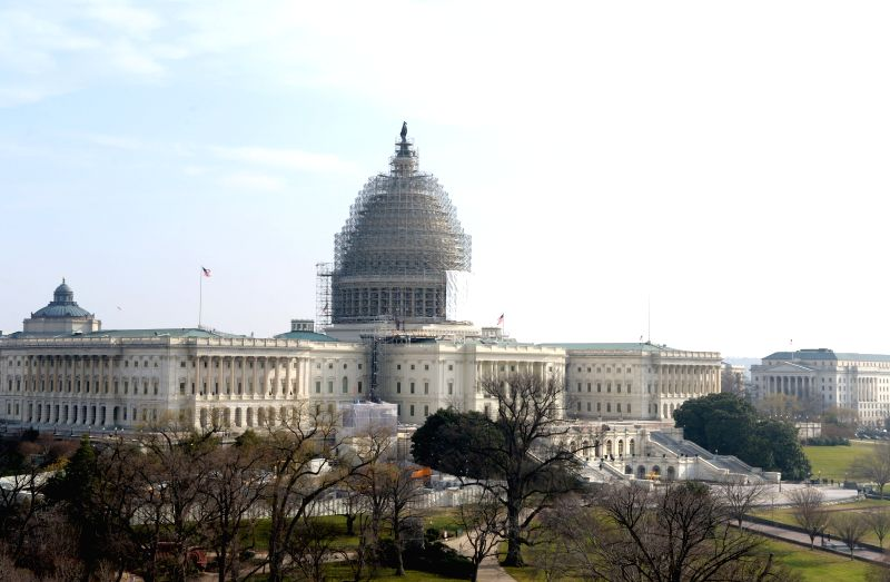 Photo taken on Dec. 13, 2014 shows the U.S. Capitol building in Washington D.C., the United States.  The U.S. Senate approved a temporary extension of ...