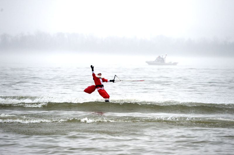 """A man dressed up as Santa Claus skis on the Potomac River during the 29th regional event for Christmas celebration called """"Water-Skiing Santa"""" in ."""