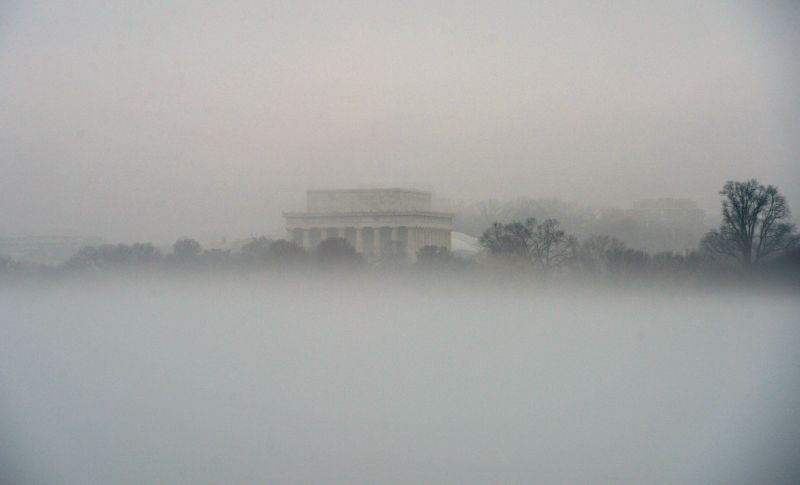 The Lincoln Memorial is seen through thick fog in Washington D.C., the United States, Dec. 24, 2014. The U.S. capital had a foggy and rainy Christmas Eve ...