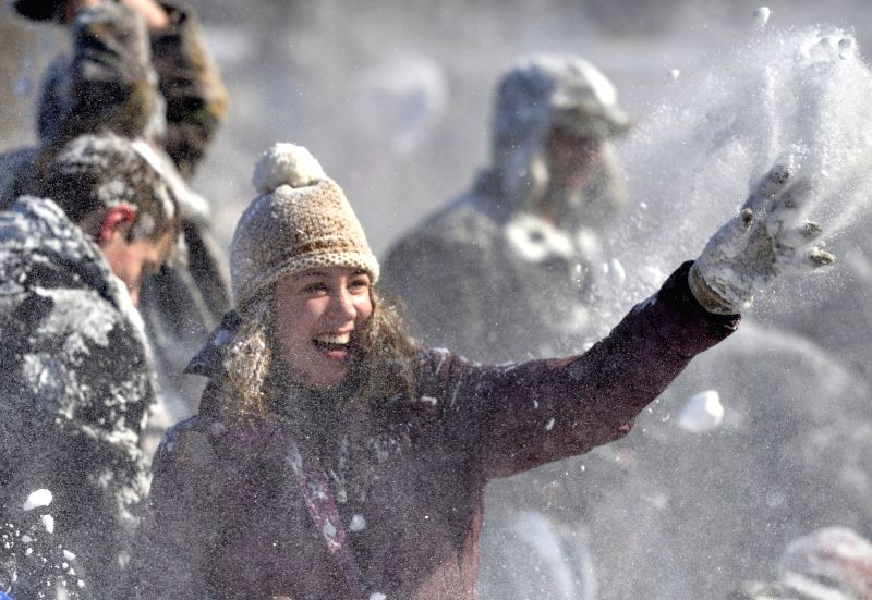 People participate in a snowball fight at Meridian Hill Park in Washington D.C., the United States, Feb. 17, 2015. The U.S. capital received 10-15cm of ...
