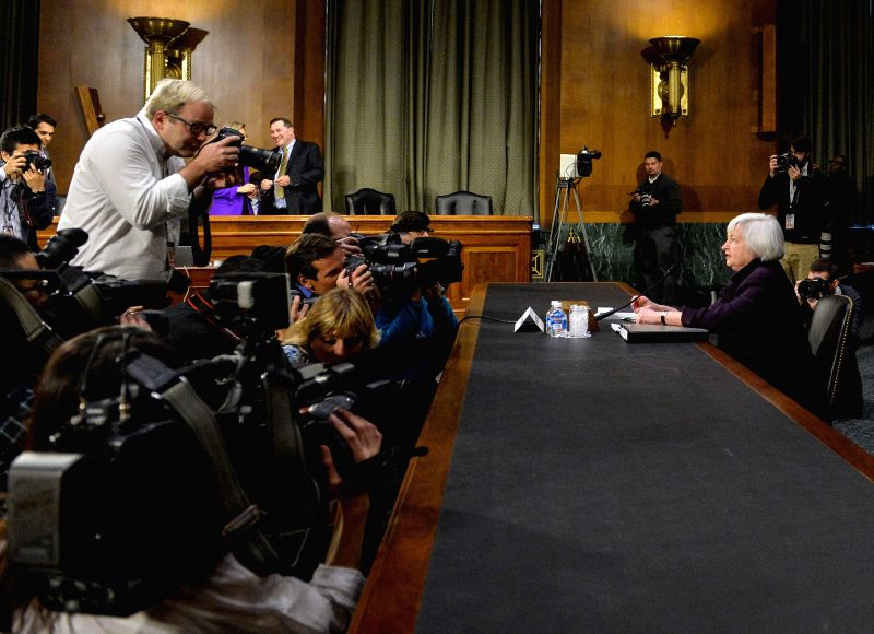 U.S. Federal Reserve chair Janet Yellen (R) prepares to testify before the senate banking, housing and urban affairs committee during a hearing on her ...