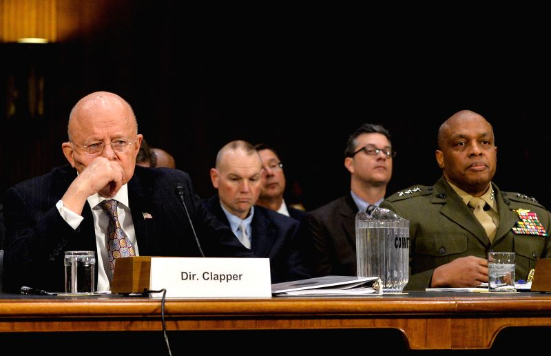James Clapper(L), Director of U.S. National Intelligence testifies before Senate Armed Services Committee on world threats at Capitol Hill in Washington ...