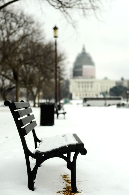Snow falls on a bench at National Mall in Washington D.C., capital of the United States, Feb. 26, 2015.