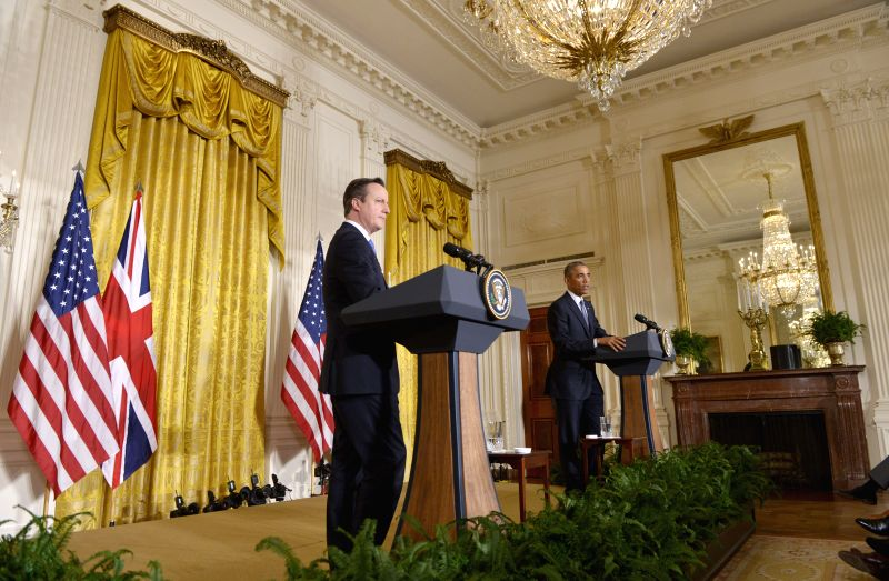 U.S. President Barack Obama (R) speaks during a joint news conference with British Prime Minister David Cameron in the East Room of the White House in ... - David Cameron