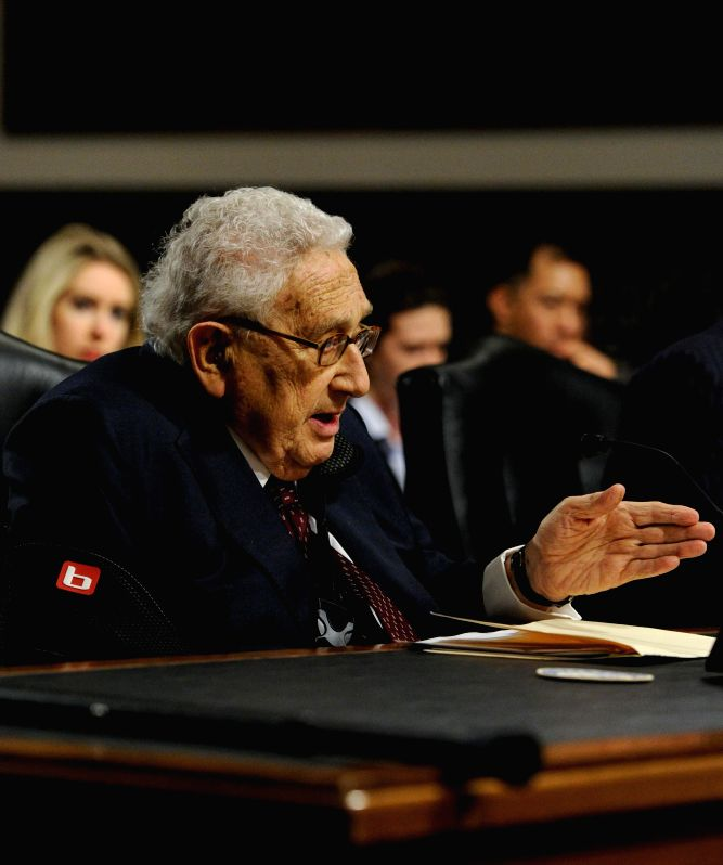 Former U.S. Secretary of State Henry Kissinger testifies before the Senate Armed Services Committee during a hearing on Global Challenges and the U.S. ...