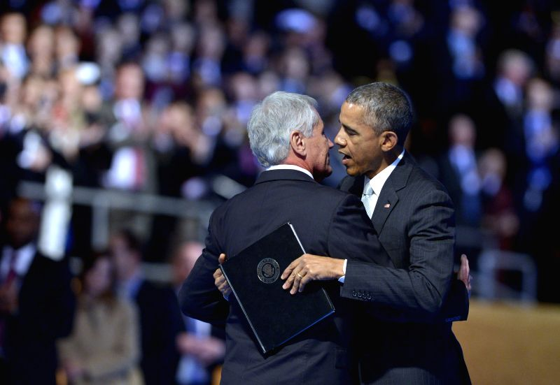 U.S. President Barack Obama (R) embraces outgoing U.S. Defense Secretary Chuck Hagel during a farewell ceremony at Virginia's Joint Base Myer-Henderson ...