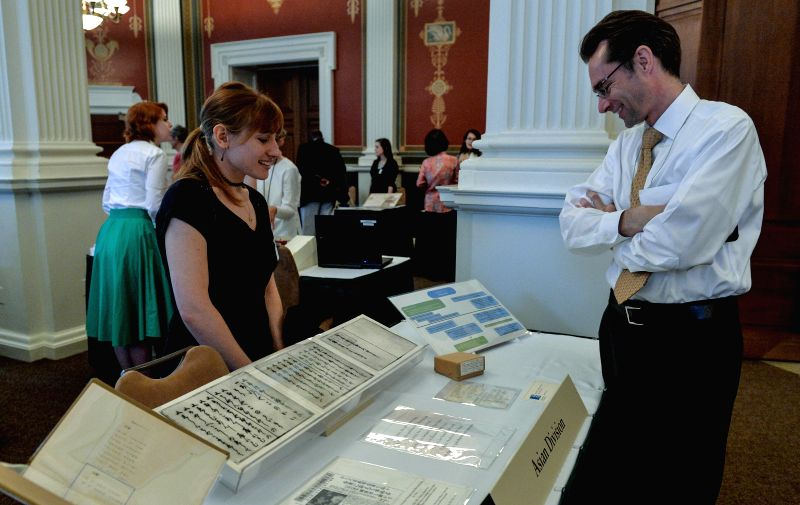 A Junior Fellow Summer Intern (L) is seen at a display of rare and unique items from the Library's collections, at the Library of Congress in Washington ...