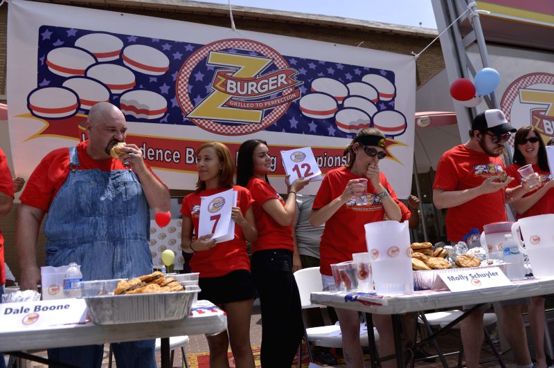 Contestants compete during the 6th annual Independence Burger Eating Championship in Washington D.C., the United States, on July 3, 2014. Molly Schuyler won .