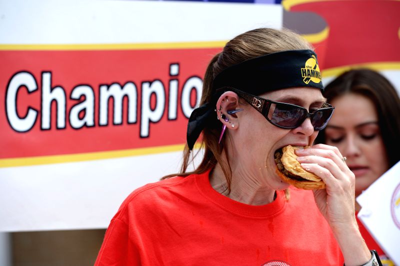 Molly Schuyler competes during the 6th annual Independence Burger Eating Championship in Washington D.C., the United States, on July 3, 2014. Molly Schuyler .