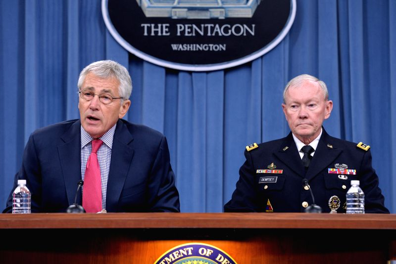 U.S. Defense Secretary Chuck Hagel (L) speaks at the Department of Defense Press Briefing at Pentagon in Washington D.C., capital of the United States, July