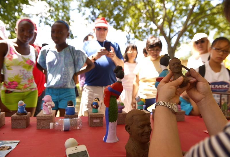 People watch a Chinese artist making clay figures during the 48th Smithsonian Folklife Festival in Washington D.C., capital of the United States, July 4, ...