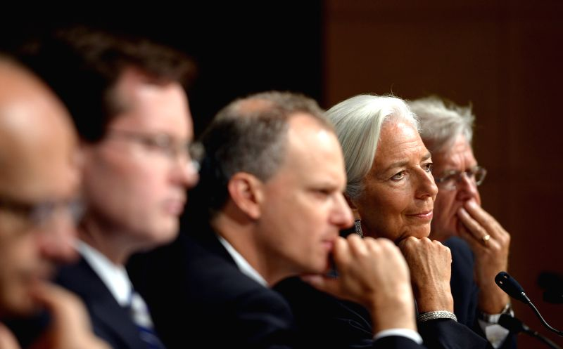 International Monetary Fund(IMF) Managing Director Christine Lagarde(2nd, R) attends a press conference at the IMF headquarters in Washington D.C., the ...