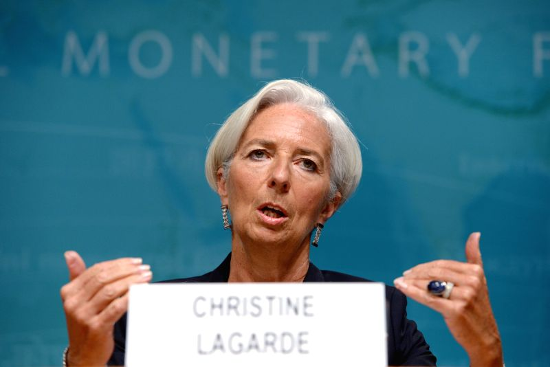 International Monetary Fund(IMF) Managing Director Christine Lagarde(R) speaks during a press conference at the IMF headquarters in Washington D.C., the ...