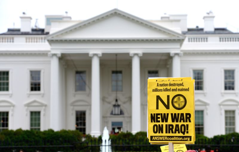 People participate in a demonstration agaisnt war on Iraq outside the White House in Washington D.C., the United States, on June 21, 2014. (Xinhua/Yin ...