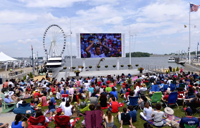 Soccer fans watch the broadcast of a Group G match between the U.S. and Germany of 2014 FIFA World Cup at the National Harbor, Maryland, the United States, .