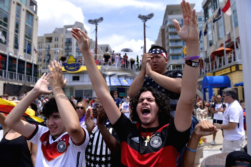 Supporters of Germany react as they watch the broadcast of a Group G match between the U.S. and Germany of 2014 FIFA World Cup at the National Harbor, ...