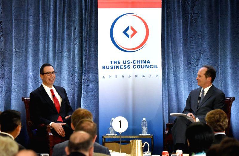 WASHINGTON D.C., June 7, 2017 - U.S. Treasury Secretary Steven Mnuchin (L) speaks during an event in Washington D.C., the United States, on June 6, 2017. U.S. Treasury Secretary Steven Mnuchin said ...