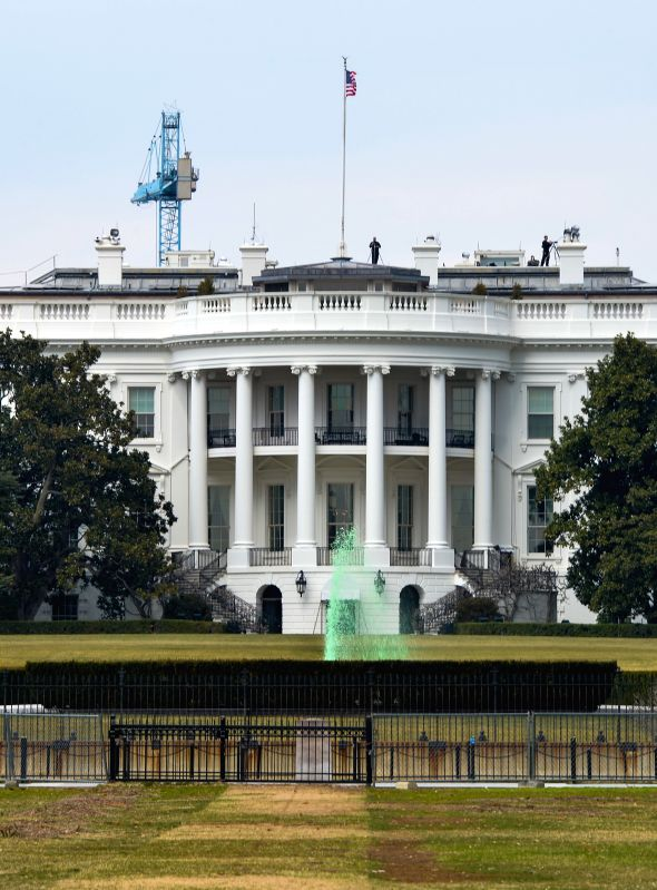 The South Lawn fountain at the White House is dyed green for St. Patrick's Day in Washington D.C., capital of the United States, March 17, 2015. ...