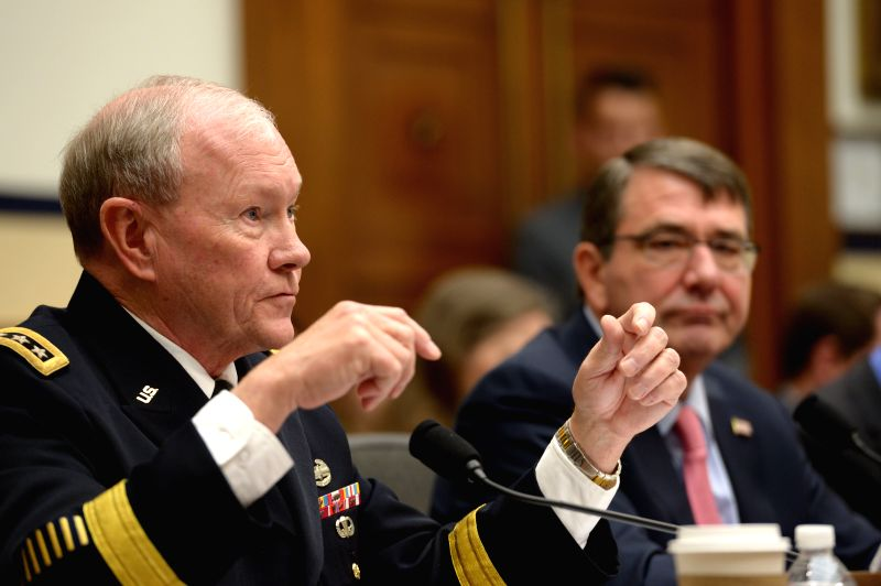 U.S. Defense Secretary Ashton Carter (R) listens as U.S. Chairman of the Joint Chiefs of Staff General Martin E. Dempsey testifies before a House Armed ...