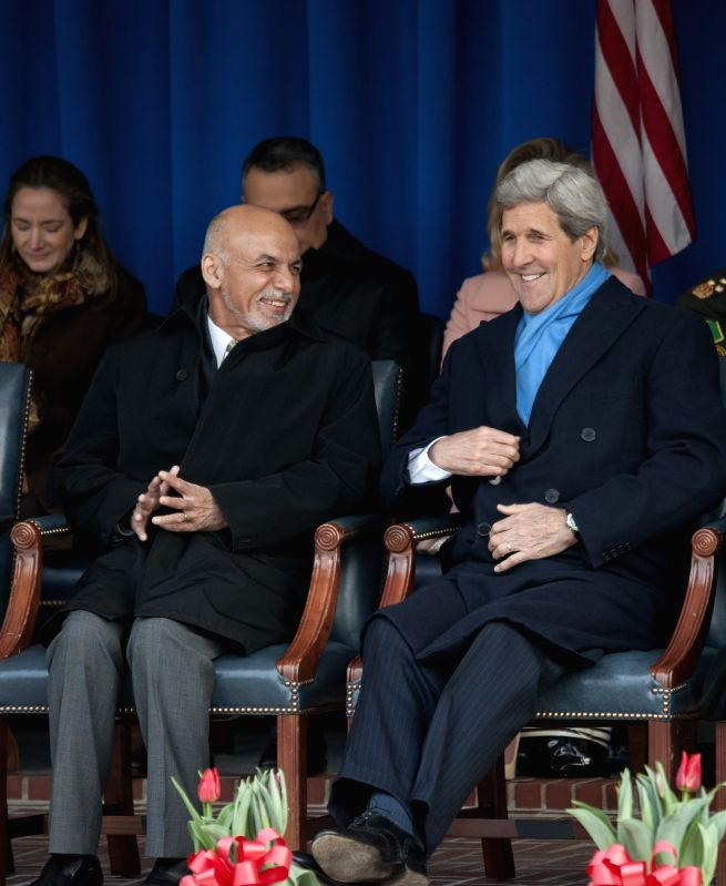 Afghan President Ashraf Ghani(L) and U.S. Secretary of State John Kerry attend an event to thank service members and veterans who have served in ...