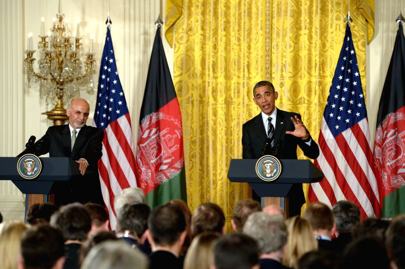 U.S. President Barack Obama(R) speaks as Afghan President Ashraf Ghani listens during a joint press conference in the East Room of White House in ...