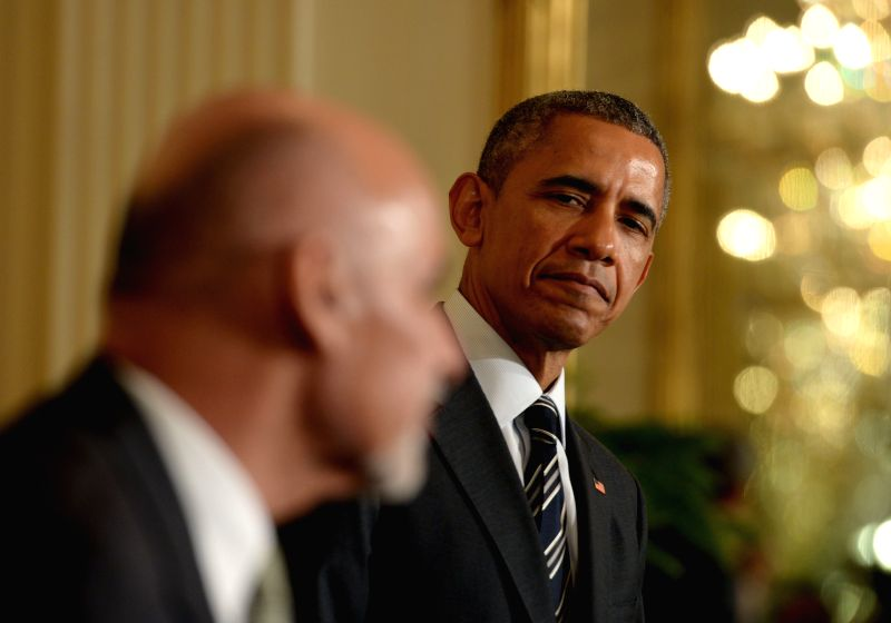 U.S. President Barack Obama(R) listens as Afghan President Ashraf Ghani speaks during a joint press conference in the East Room of White House in ...
