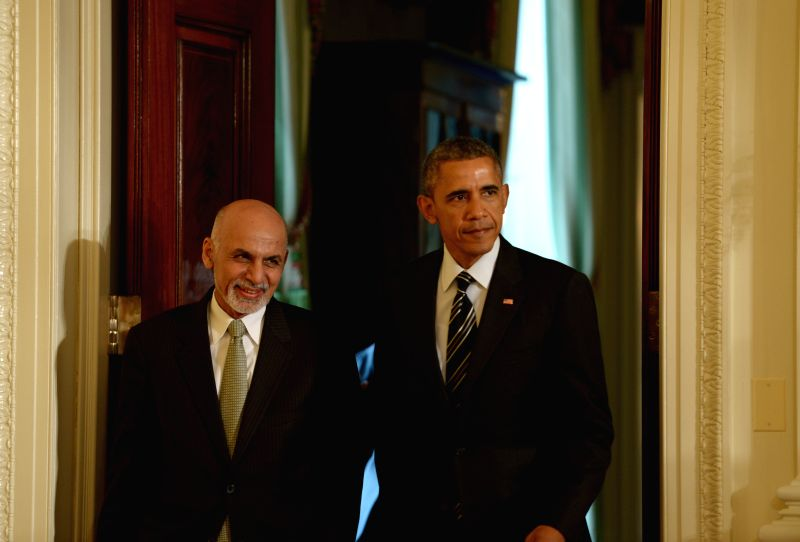 U.S. President Barack Obama(R) and Afghan President Ashraf Ghani arrive for a joint press conference in the East Room of White House in Washington D.C., ...