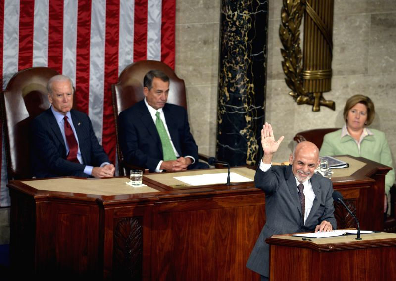 Afghan President Ashraf Ghani(R) addresses a joint meeting of Congress on Capitol Hill in Washington D.C., the United States, March 25, 2015.  Visiting ...