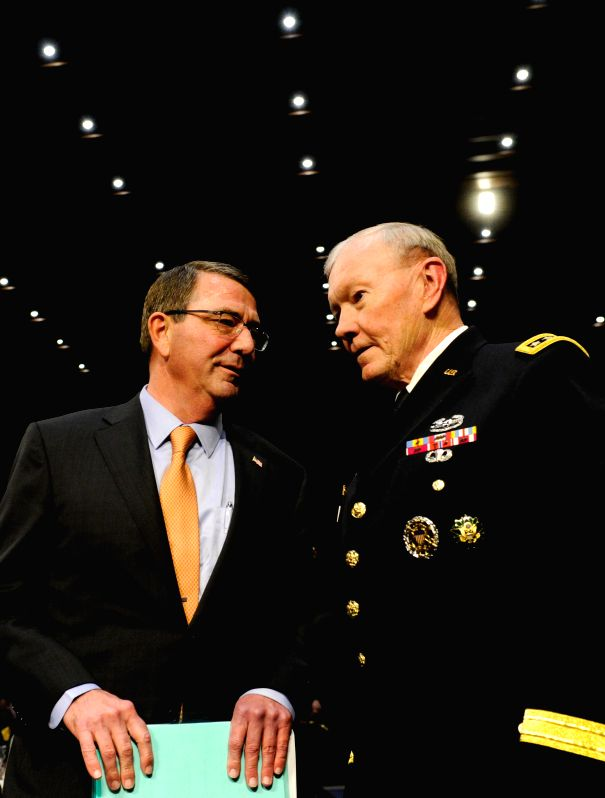 U.S. Defense Secretary Ashton Carter (L) and U.S. Chairman of the Joint Chiefs of Staff General Martin E. Dempsey prepare to testify before a Senate Armed ...