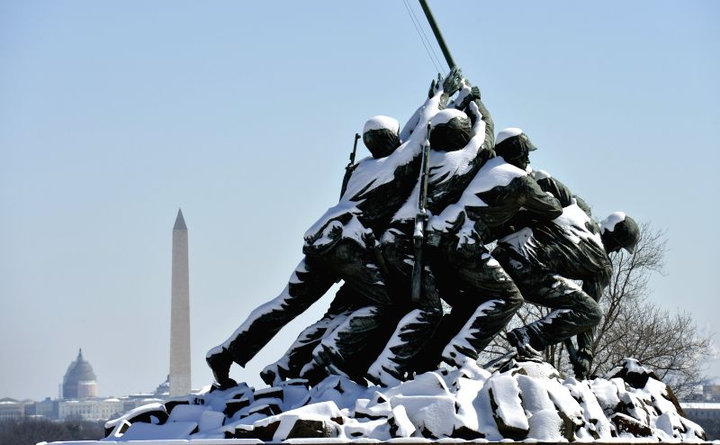 The Marine Corps War Memorial, Washington Monument, and US Capitol building are seen after snowfall in Washington D.C.,the United States, on March. 6, ...