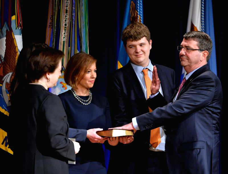 U.S. Defense Secretary Ashton Carter (1st R) swears in during the Ceremonial Swearing-in in the Pentagon Auditorium in Washington D.C., capital of the ...