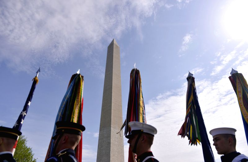 Honor guards stand in front of the Washington Monument during a reopening ceremony, in Washington D.C., the United States, on May 12, 2014. The iconic ...