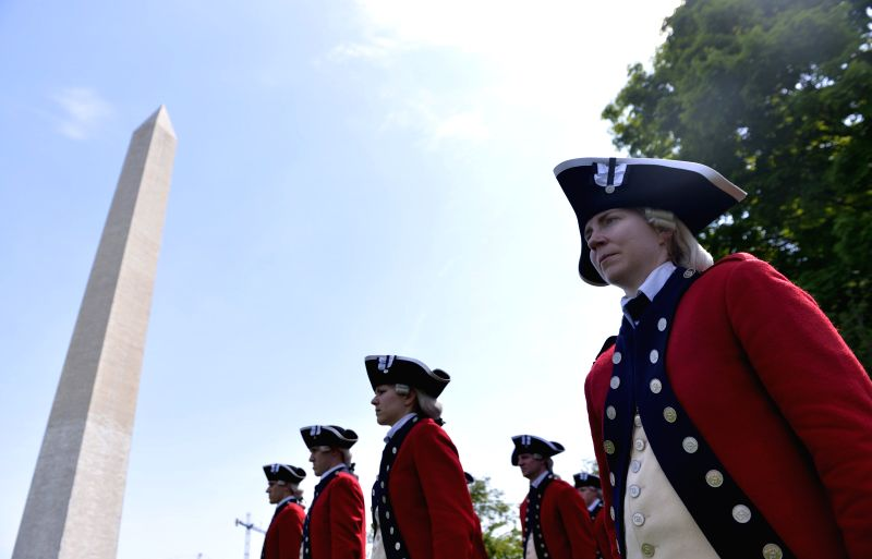 Soldiers of a military band perform during the reopening ceremony of the Washington Monument, in Washington D.C., the United States, on May 12, 2014. The ...