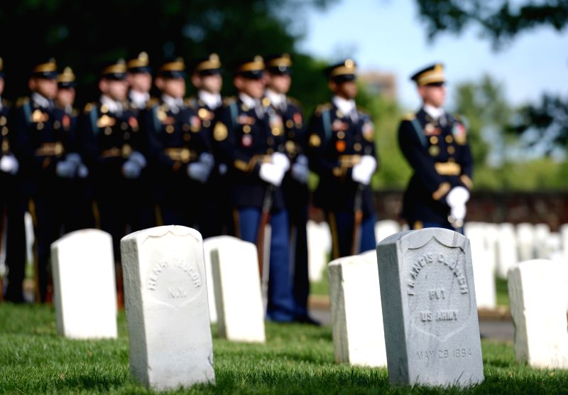 Soldiers of honor guard attend a ceremony marking the 150th anniversary of Arlington National Cemetery in Arlington, Virginia, the United States, on May 13, .