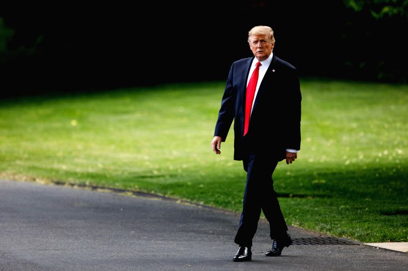 WASHINGTON D.C., May 21, 2019 (Xinhua) -- U.S. President Donald Trump leaves the White House in Washington D.C., the United States, on May 20, 2019. U.S. President Donald Trump said Monday that he disagrees with a court ruling that backs a congressio