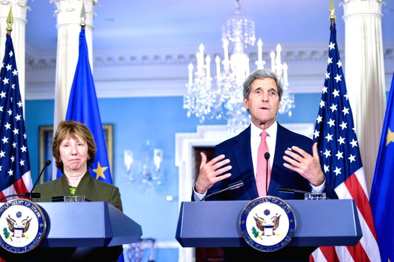 U.S. Secretary of State John Kerry (R) speaks during a joint news conference with EU foreign policy chief Catherine Ashton at the State Department in ...
