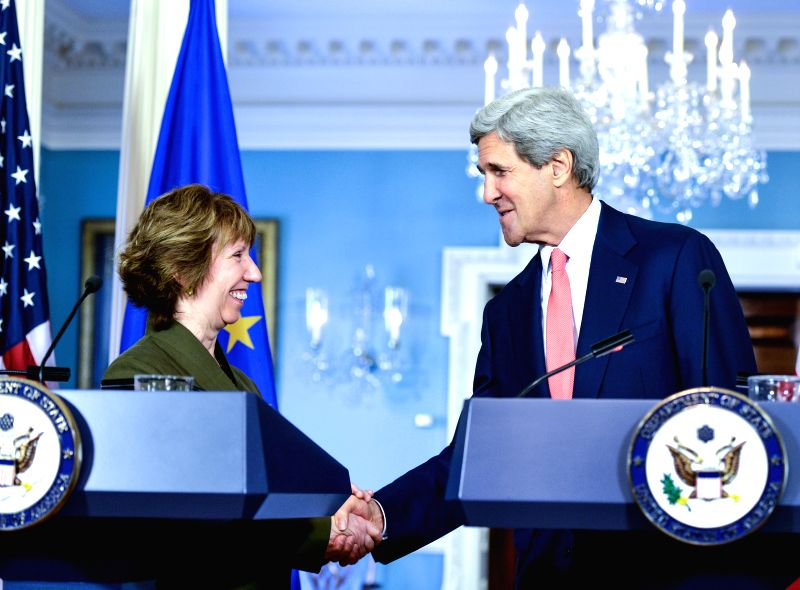 U.S. Secretary of State John Kerry (R) shakes hands with EU foreign policy chief Catherine Ashton during a joint news conference at the State Department in ...