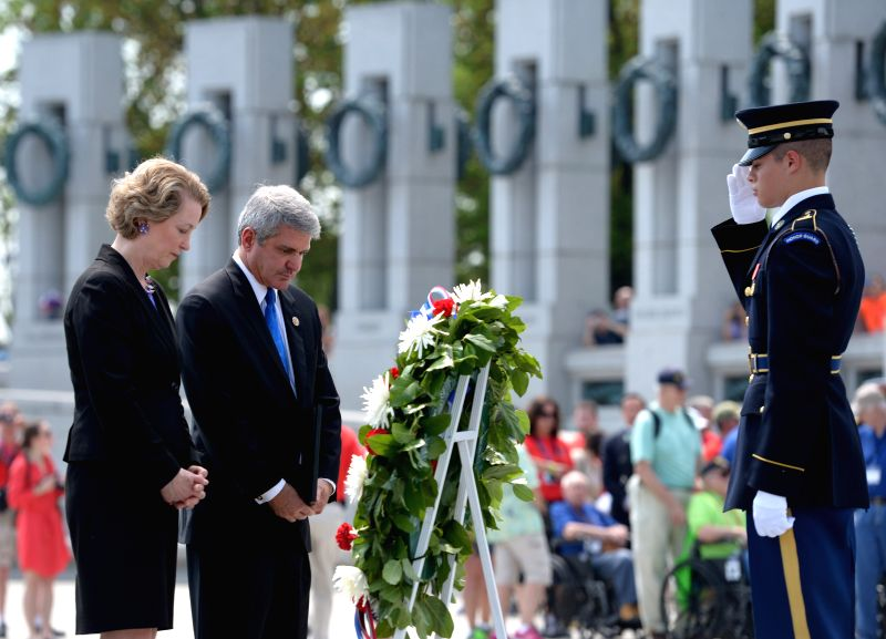 Photo:  Susan Eisenhower (L), granddaughter of late President Dwight D. Eisenhower, observes a moment of silence after placing a wreath during a ceremony ...