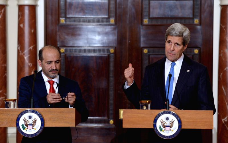 Photo: U.S. Secretary of State John Kerry (R) and the President of the Syrian National Coalition (SNC) Ahmad Al-Jarba (L) speaks to the media before their ...