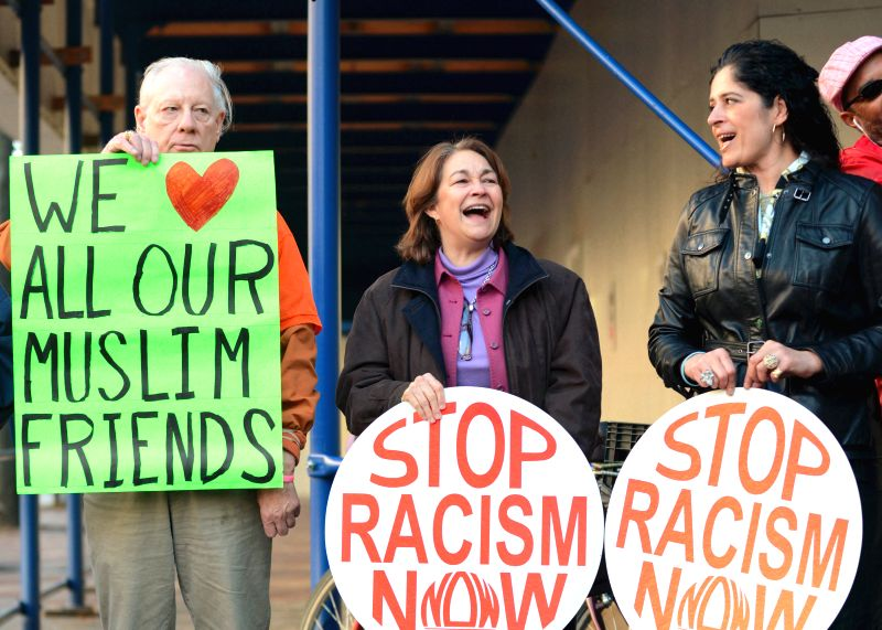 Washington D.C.: Members of the anti-war group Code Pink protest against U.S. Republican presidential candidate Donald Trump's racism words before the Trump Hotel in Washington D.C., the United ...