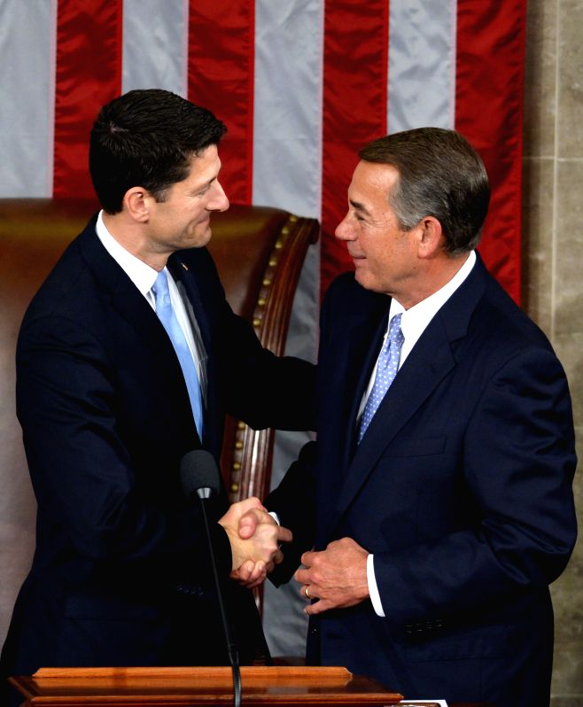 WASHINGTON D.C., Oct, 29, 2015 House Speaker John Boehner (R) shakes hands with his successor Paul Ryan after the latter was elected as the new Speaker of the U.S. House of ... - John Boehner