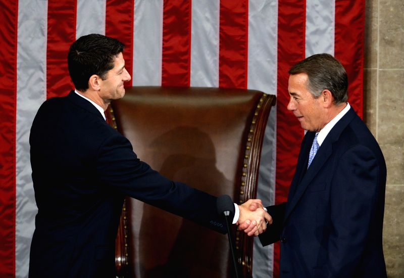 WASHINGTON D.C., Oct, 29, 2015 Outgoing speaker John Boehner (R) shakes hands with his successor Paul Ryan in the House Chamber on Capitol Hill, in Washington D.C., the United States, ...