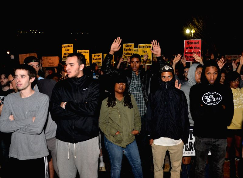 Washington D.C: People protest against the grand jury's decision not to charge police officer Darren Wilson in the fatal shooting of African American youth Michael Brown in Ferguson in August, in ...