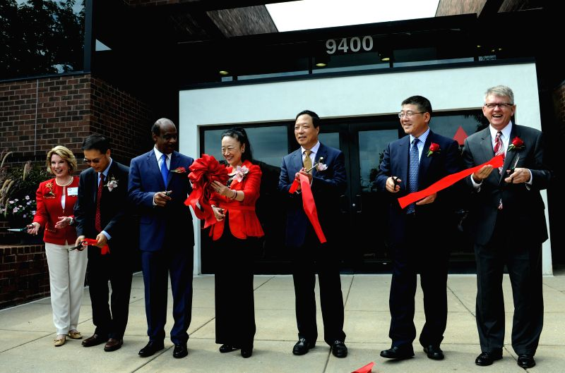 A ribbon-cutting ceremony is held marking the official launch of Tasly Pharmaceuticals as Tasly Holding Group's North American headquarters, in Rockville, ..