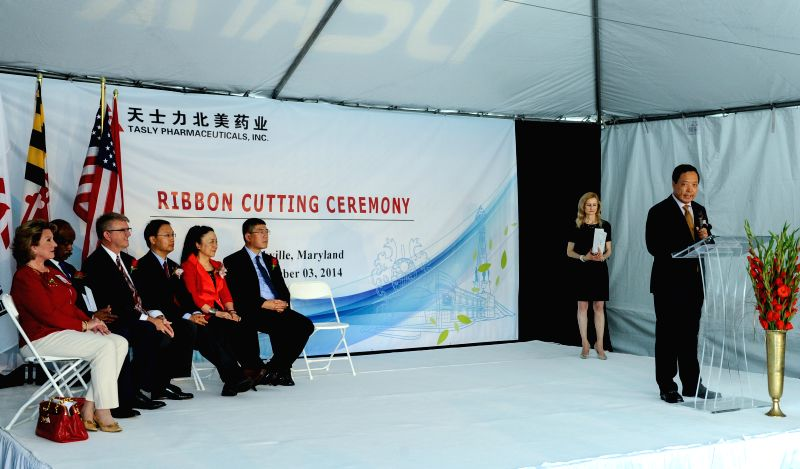 Chairman of Tasly Yan Xijun (1st R) speaks during a ribbon-cutting ceremony marking the official launch of Tasly Pharmaceuticals as Tasly Holding Group's ...